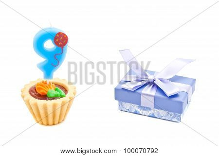 Cake With Nine Years Birthday Candle And Gift On White