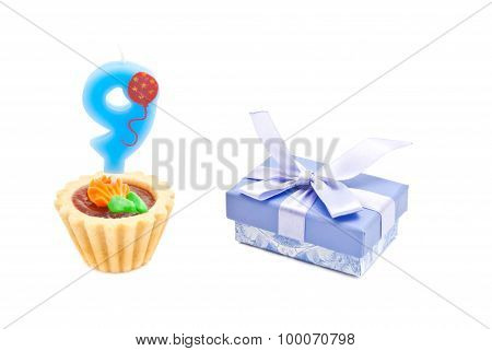 Cake With Nine Years Birthday Candle And Gift