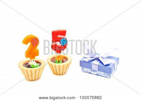 Cakes With Twenty Five Years Birthday Candles And Gift On White