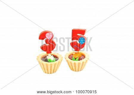 Cakes With Thirty Five Years Birthday Candles On White