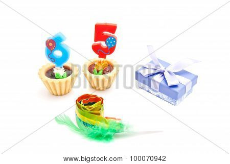 Cakes With Sixty Five Years Birthday Candles, Whistle And Gift On White