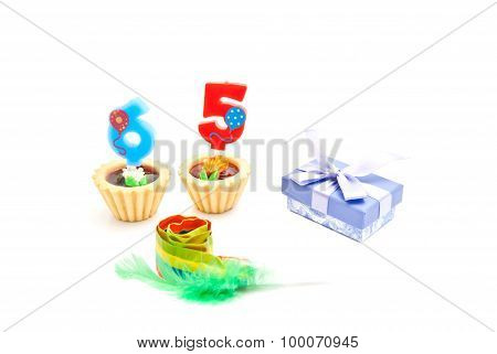 Cakes With Sixty Five Years Birthday Candles, Whistle And Gift