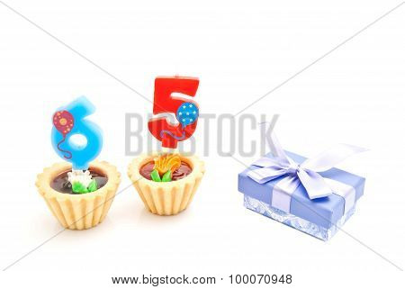 Cakes With Sixty Five Years Birthday Candles And Gift