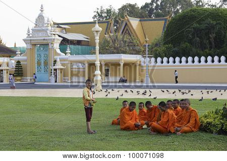 Young Buddhist Monks In A Garden, Phnom Penh, Cambodia