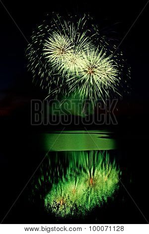 Green Fireworks Over Water