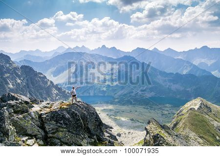 Middle Aged Man Enjoying Adventure In The Mountains
