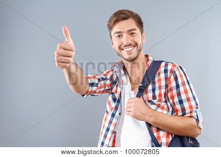 Positive student thumbing up