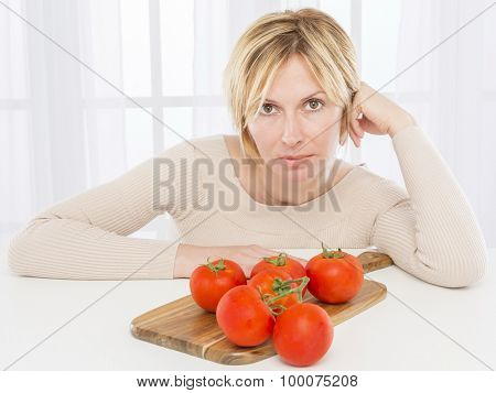 Forty years woman and tomato