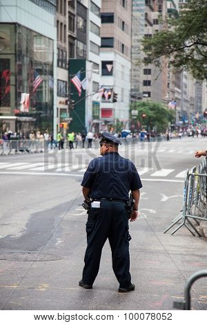 NEW YORK CITY, USA - SEPTEMBER, 2014: NYPD policeman securing the New York City Labor Day Parade 2014