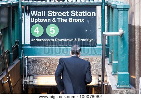 NEW YORK CITY, USA - SEPTEMBER, 2014: Businessman entering the Wall street subway station