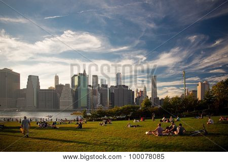 NEW YORK CITY, USA - SEPTEMBER, 2014: New Yorker enjoying the sunset at Brooklyn Bridge Park