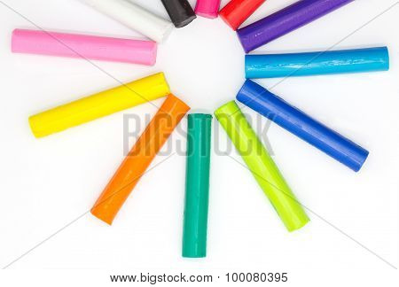 Colourful of child's play clay on white background