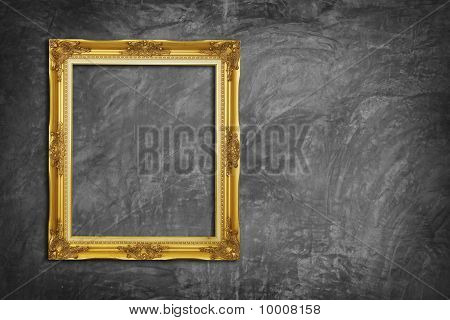 Golden Frame On Concrete Wall