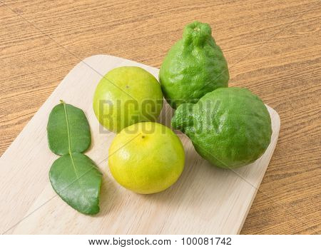 Kaffir Lime With Lemon Lime On Wooden Board