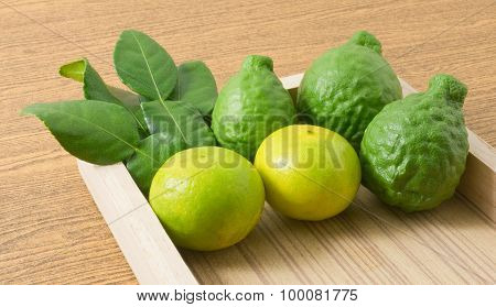 Kaffir Lime With Lemon Lime On A Wooden Tray