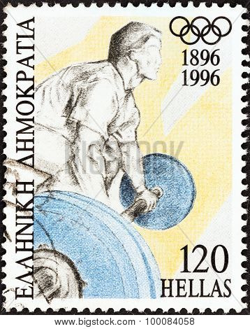 GREECE - CIRCA 1996: A stamp printed in Greece shows a weightlifter