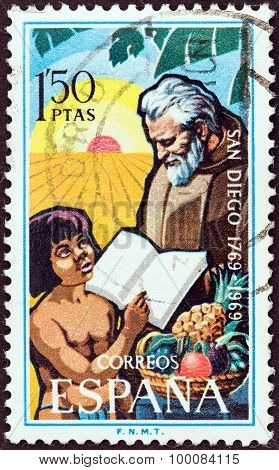 SPAIN - CIRCA 1969: A stamp printed in Spain shows Franciscan Friar and child