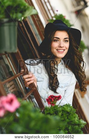 Young Woman With Hat In Urban Background Wearing Casual Clothes