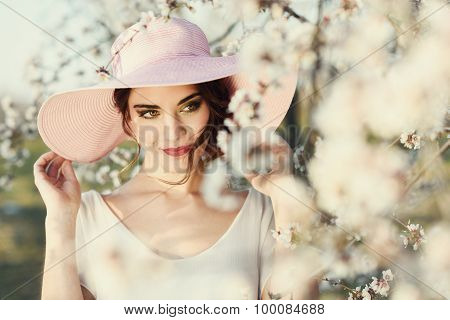 Portrait Of Young Woman In The Flowered Garden In The Spring Time