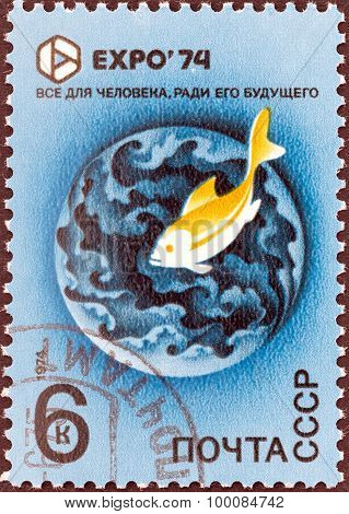 USSR - CIRCA 1974: A stamp printed in USSR shows Preserve the Environment. Fish and globe (The Sea)