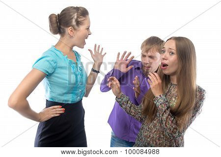 Image of businesswoman screaming at frightened subordinates