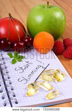 Fruits And Tablets Supplements With Notebook, Slimming And Healthy Food