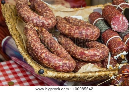 Freshly Prepared Raw Sausage In Basket On Stall