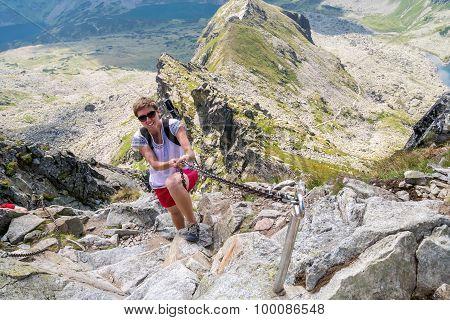Young Woman Climbing High Mountains