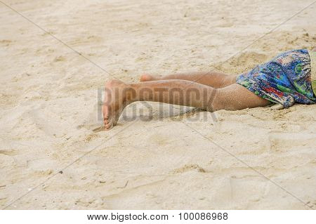 Children Legs When He Lay Down On The Beach