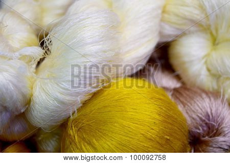 white yellow silks thread roll abstract background