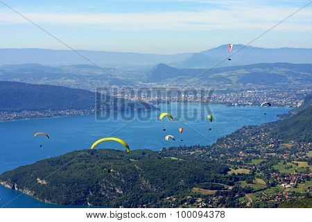 Paragliders above Lake Annecy