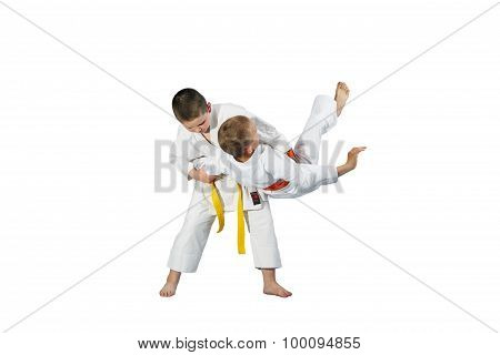 Children are doing high throws judo in judogi