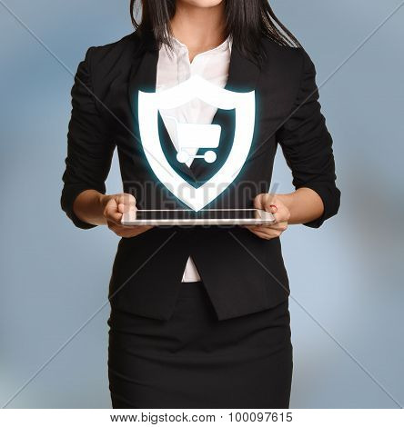 Woman is holding tablet with shield cart icon