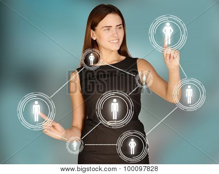 Girl touches the human icons and gears