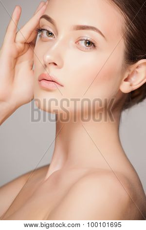 Fashion woman with beautiful face - isolated on white. Skin care concept.