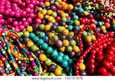 Colorful Strings Of Semiprecious, Wooden And Glass Bead Necklaces Displayed For Sale
