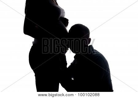 Silhouette of listening man and woman's belly