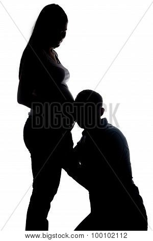 Silhouette of listening husband and wife's belly