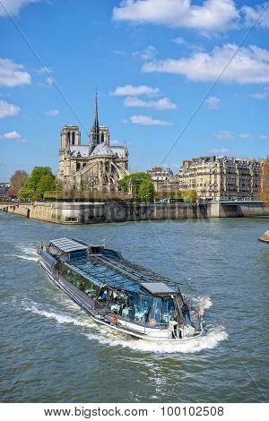 Ship On River Seine And Cathedral Notre Dame De Paris