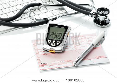 Glucose Meter And Recipe On The  Doctors Desk