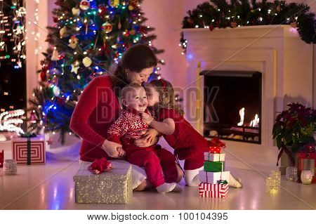Mother And Children At Home On Christmas Eve