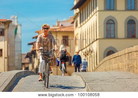Cyclist on Bridge Santa Trinita, Florence, Italy