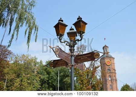 Old lantern with street signs