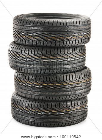 Four New Black Tires Isolated On White