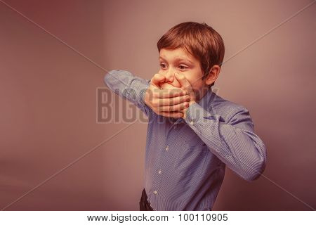 teenager boy 10 years of European appearance closed mouth with h