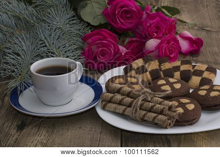 Cup Of Coffee, Roses And Plate With Different Cookies On A Table