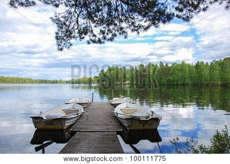 Wooden Pier With Rowing Boats
