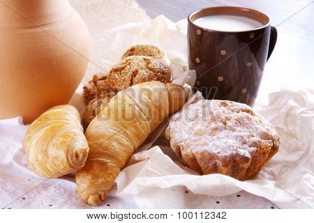Homemade Pastries And A Cup Of Milk