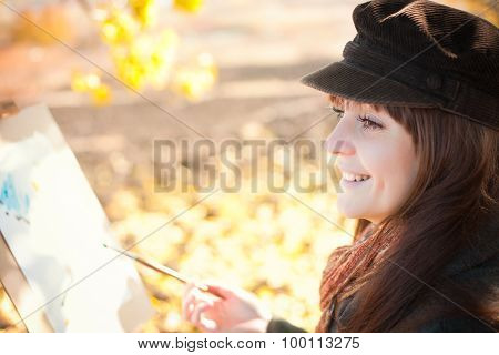Portrait Of A Young Beautiful Woman With A Brush In Her Hand