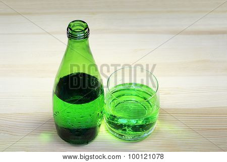 Bottle And Glass Of Sparkling Mineral Water With Tarragon
